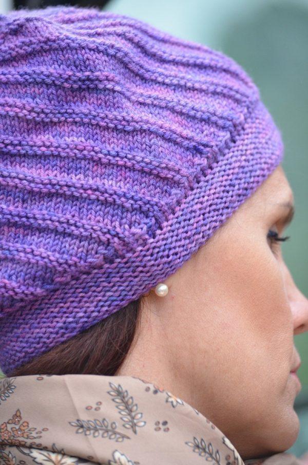 Aeron Hat close up of band